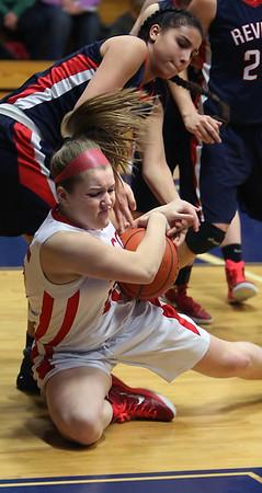 KEN YUSZKUS/Staff photo.  Masco's Nicole Tapparo wrestles for the ball under the basket during the Masconomet vs. Revere girls basketball held at St. Mary's.   02/16/15