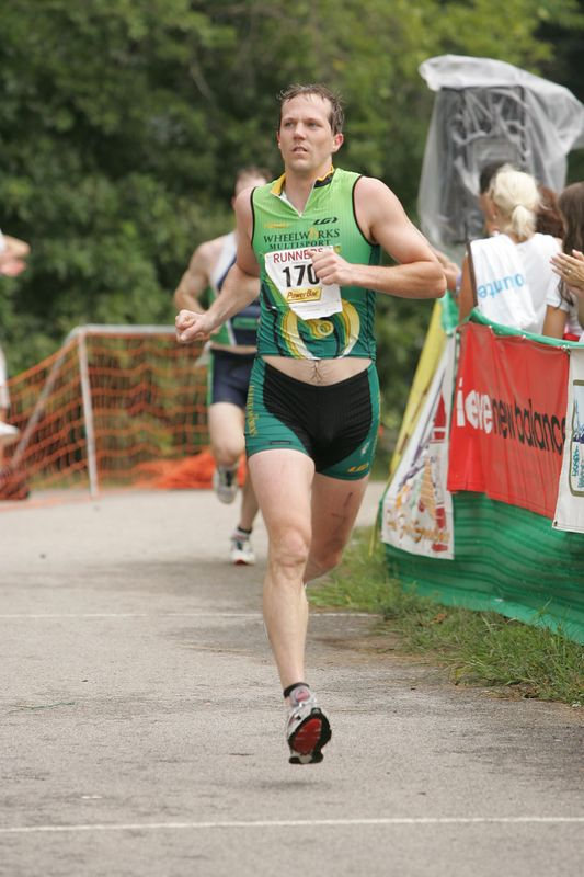 Brian Doldt races down the finish line in a time of 1:16:21