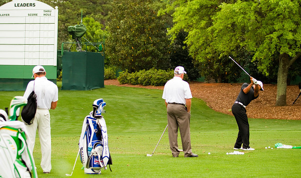 Mark O'Meara looks on as Tiger Woods swings - 2012 Masters