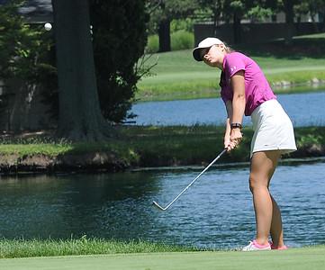 Annika Neumann of Avon chips at Ohio Girls Golf Foundation showcase at Avon Oaks Country Club on July 17.   STEVE MANHEIM / CHRONICLE