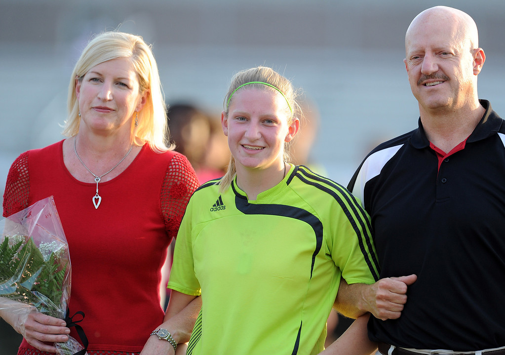 Hillcrest goalkeeper Cortney Curtis and her parents are recognized on Senior Night.<br /> The Hillcrest Rams played host to the Woodmont Wildcats in a soccer match.<br /> GWINN DAVIS PHOTOS<br /> gwinndavis@gmail.com  <br /> (864) 915-0411