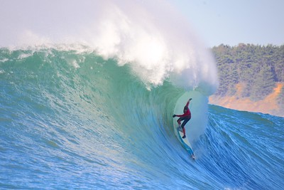 Peter Mel getting barreled. He would go on to become the winner of the 2013 Mavericks Invitational.