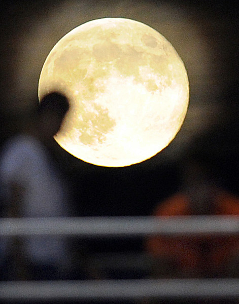 Did you see this?<br /> A Full Moon, and this one know as a Blue Moon, shines brightly over Mauldin's Freeman Field Friday night during the Mauldin-Woodmont Football Game.<br /> According to NASA, this was the second time in August that a full moon was seen - the first was on August 1 to 2. This phenomenon, which is referred to as the 'blue moon', happens every two and a half years on average.<br /> The Mauldin Mavericks played host to the Woodmont Wildcats in a Class-AAAA football game.<br /> GWINN DAVIS PHOTOS<br /> gwinndavisphotos.com (website)<br /> (864) 915-0411 (cell)<br /> gwinndavis@gmail.com  (e-mail) <br /> Gwinn Davis (FaceBook)