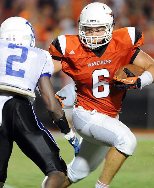 Mauldin's Beau Craft turns upfield.<br /> The Mauldin Mavericks played host to the Woodmont Wildcats in a Class-AAAA football game.<br /> GWINN DAVIS PHOTOS<br /> gwinndavisphotos.com (website)<br /> (864) 915-0411 (cell)<br /> gwinndavis@gmail.com  (e-mail) <br /> Gwinn Davis (FaceBook)
