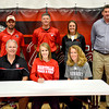 Neoga's Courtney Croy signs with the Maryville University track and field team Friday afternoon at Neoga High School. In the front row with her is her father Dan Croy and her mother Cheryl Croy. Back row, from left: Maryville track and field coach Micky Kaufman, Neoga track coach Tim Mueller, Neoga assistant track coach Jaimee Roy and Neoga athletic director Jeff Wooters.