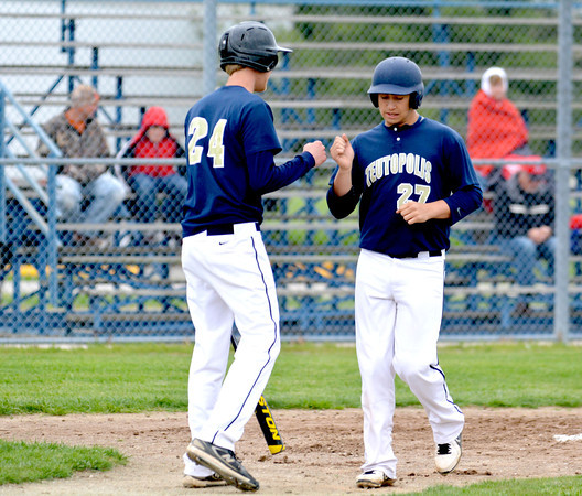 Teutopolis' Bobby Wenthe (right) bumps fists with Darren Probst (left) after a three-run home run against Neoga.