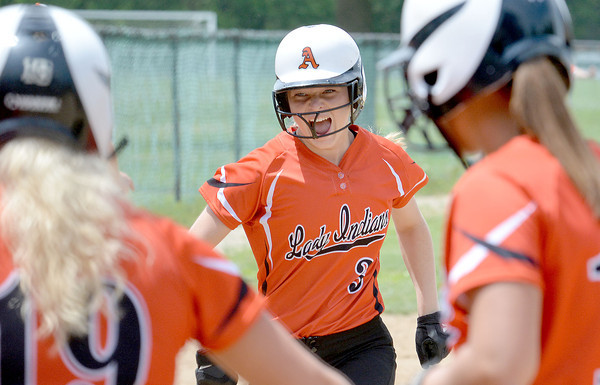 Altamont's Deidre Ledbetter runs into a mob of her teammates after a two-run home run in the fourth inning of the Class 1A Altamont Regional championship game. Ledbetter helped the Indians win the title with a 10-3 victory against Stew-Stras/Windsor.