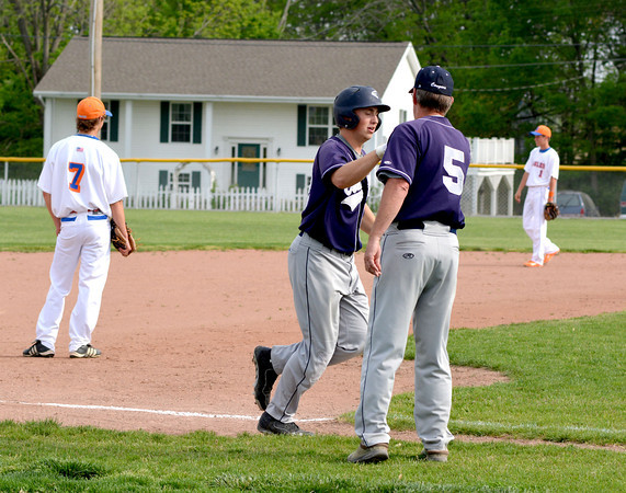 South Central's Dylan Smith is congratulated by coach Curt Jones as he rounds third base after his first-inning two-run home run against Newton.