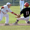 Neoga second baseman Zach Monroe slaps a tag on a runner from Central A&M during the Class 1A Windsor Regional.