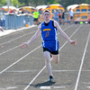 Cowden-Herrick's Adam Doty spreads his arms out after winning the 100-meter preliminary at the Class 1A Newton Sectional.