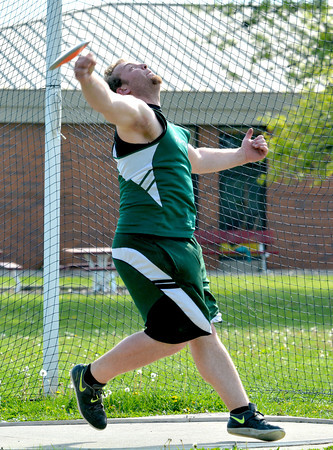Stew-Stras' Jason Fry releases the discus and follows through after finishing his throw at the National Trail Conference championship meet.