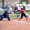 Altamont's Josie Phillips takes a cut at an incoming pitch at St. Anthony.