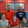 St. Anthony's Alex Hoelscher signs with the Kaskaskia College baseball team Thursday afternoon at St. Anthony's High School. His father Rick Hoelscher and his mother Pam Hoelscher sit with him in the front row. In the back row St. Anthony's head baseball coach Kenny Koenig stands with the head baseball coach with Kaskaskia College Mitch Koester.