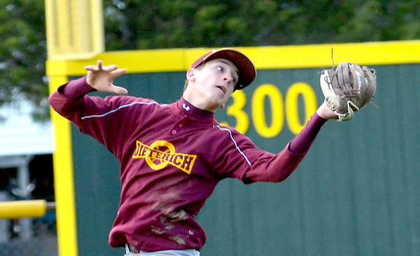 Dieterich shortstop Alex Bohnhoff reaches back and catches a fly ball during a 12-2 loss against South Central.