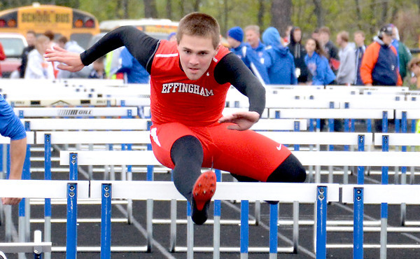 Effingham's Collin Hecht clears a hurdle during the Eagle Invite.