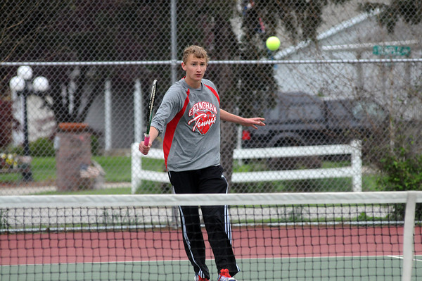 Effingham's Aaron Meyers returns a serve from St. Anthony's Jay Niebrugge Thursday afternoon.