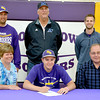 Brownstown/St. Elmo pitcher Jacob Behrends signs a letter of intent to Lewis and Clark Community College. Behrends (center) is surrounded by his parents (from left) Jayce and Dave Behrends. Standing behind him (from upper left) is Brownstown/St. Elmo head baseball coach Ryan Beccue, Lewis and Clark baseball coach Randy Martz and B/SE assistant coach Vince Rohr.