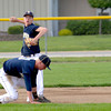 Teutopolis shortstop Cody Will throws over third baseman Louis Niemerg to first base for an out during the Wooden Shoes' 9-1 win against Effingham.