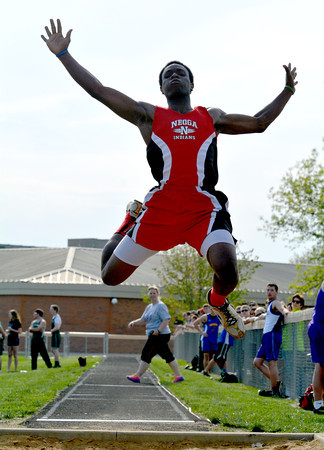 Neoga's Corey Kersey soars through the air during the long jump at the National Trail Conference championship meet in Altamont.