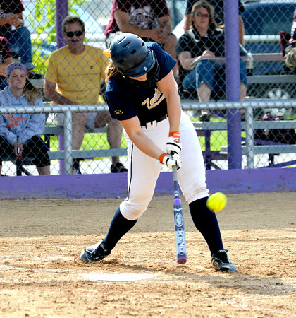 Teutopolis' Anni Borries takes a cut at a low pitch and golfs it out for an RBI double during the first inning of the Lady Shoes' 8-1 win over Robinson at the Class 2A Casey-Westfield Sectional.