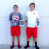 Effingham's Jason Wohltman and Jared Minor pose with their trophies from winning the second doubles flight at the Charger Doubles Invitational in Champaign, a tournament which Effingham would win overall.
