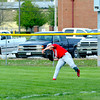 Effingham right fielder Michael Woltman fires a ball back toward the infield against Teutopolis.