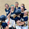 Teutopolis' Kaitlin Smith (center) is greeted at home by Mackenzie Wermert (right) after a third-inning solo home run, while the rest of the Lady Shoes surround them at the plate in an 8-1 Class 2A Casey-Westfield Regional win over Robinson.