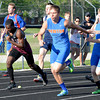 Newton's Zack Lewis hands off to Luke Stone in the 4x100-meter relay, an event the Eagles qualified for state in at the Newton Sectional.