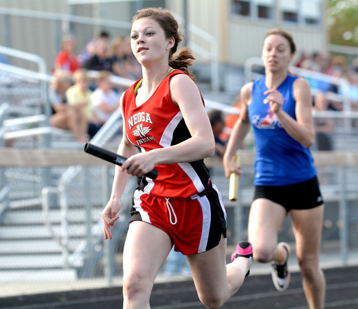 Neoga's Mallori Harshman edges out St. Anthony's Lauren Wendt in the final meters of the 4x100-meter relay at the National Trail Conference championship meet in Altamont
