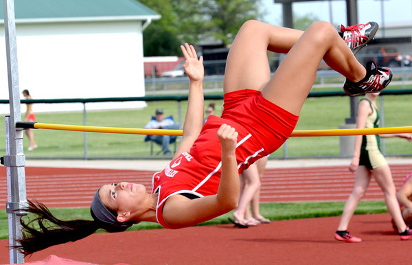 Effingham's Jaclyn Steppe clears the bar during the high jump event at the Apollo Conference track meet in Effingham.