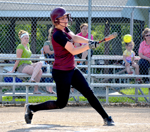 Dieterich's Mallorie Vahling hits a line drive to the pitcher during the National Trail Conference tournament against St. Elmo/Brownstown.