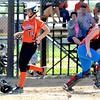 Altamont's Madison Ohnesorge steps on home plate safely for a run while St. Anthony's Hunter Niebrugge (right) waits for an incoming throw to the plate.