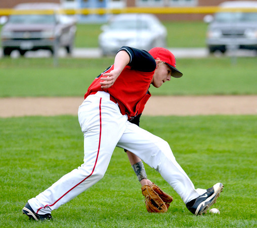 Neoga third baseman Zach Monroe scoops up a ground ball during the Indians' loss to Teutopolis Thursday.