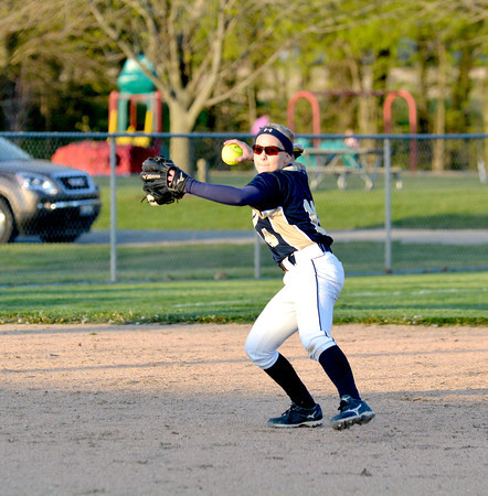 Teutopolis' Madison Cowman fields a grounder and prepares to fire to first during the Cross Creek Classic against St. Anthony.