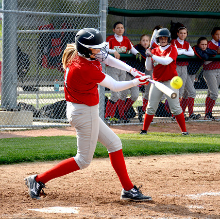 Effingham's Hope Collier makes contact on a flyball during the City Series' first and only game against St. Anthony, a 12-11 Bulldogs' win.