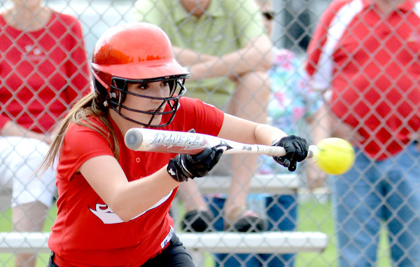 Neoga's Kyndall Andrews squares around for a bunt in the first inning of the Indians' 8-6 loss against St. Anthony in the National Trail Conference Tournament