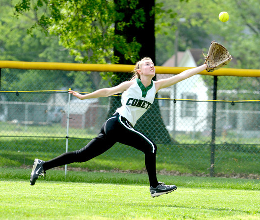 Stew-Stras/Windsor right fielder Megan Cress lunges for a flyball during the NTC title game against Altamont, successfully stretching out to make the catch .