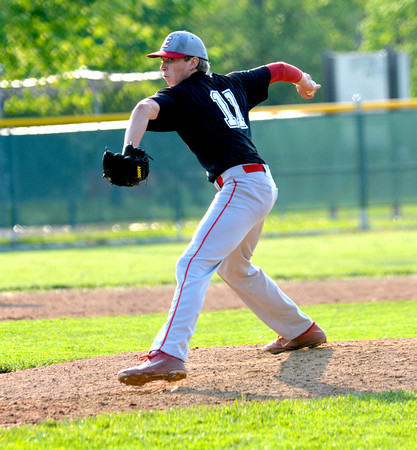 Effingham pitcher Kevin Daugherty winds and delivers during game one of the City Series, a 6-2 Effingham win. Game two was suspended with a 2-0 Effingham lead.