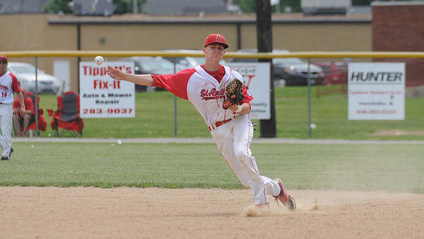 St. Anthony's Neil Williams fields a ground ball and fires it to first base during the Bulldogs' 3-0 loss at the Class 2A Vandalia Regional final to Shelbyville.