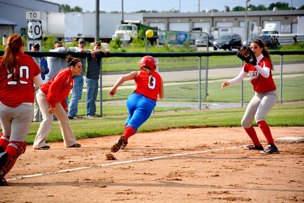 St. Anthony's Paige Koester (9, center) is caught in a rundown between third and home and Effingham catcher Kaylee Tonn (left, 20) and Shelby Nunamaker (right).