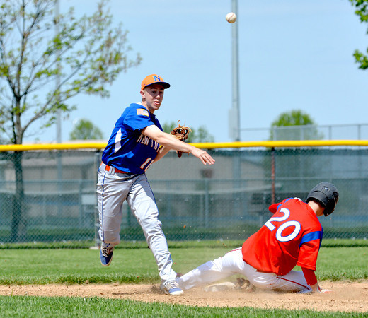 Newton's Nate Meinhart forces out St. Anthony runner Ethan Greene (20) and throws the ball to first to successfully complete a double play during the third inning against St. Anthony.