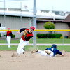 Teutopolis' Alex Goldstein slides safely into second base on a stolen base attempt in the first inning while Neoga's Jordan Hoedebecke attempts to slap the tag on Thursday afternoon.