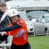 Altamont's Deidre Ledbetter begins her swing during the Indians' 9-3 victory against St. Anthony. Ledbetter went 2-for-4 with an RBI and three runs scored, while pitching a three-hitter.