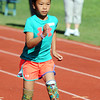 Globe/T. Rob Brown<br /> Haven Shepherd, a Carthage Elementary School third grader, races during a school track meet Wednesday morning, May 9, 2012, at K.E. Baker Stadium in Carthage. Shepherd, who was adopted by a Carthage family, is originally from Vietnam. She lost her legs during an explosion when she was a 1-year-old.