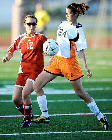 Globe/T. Rob Brown<br /> Carl Junction's Paige Kennedy and Republic's Sara Marcotte compete for control of the ball Wednesday night, May 16, 2012, at Carl Junction's field.