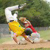 Effingham 's Drew Levitt tags out Mattoon's Payton Hartbank at home plate in the fourth inning of the teams' Olney Regional championship showdown. Hartbank was attempting to score from third on a passed ball, but EHS catcher Carter Hayes flipped the ball to Levitt in time to cut down Hartbank at the plate.