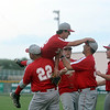 Effingham pitcher Devin Mayfield is lifted up by Effingham assistant coach Ron Diehl (22) and rubs the head of head coach Chris Fleener immediately following Effingham's 4-2 win over Olney in 12 innings.
