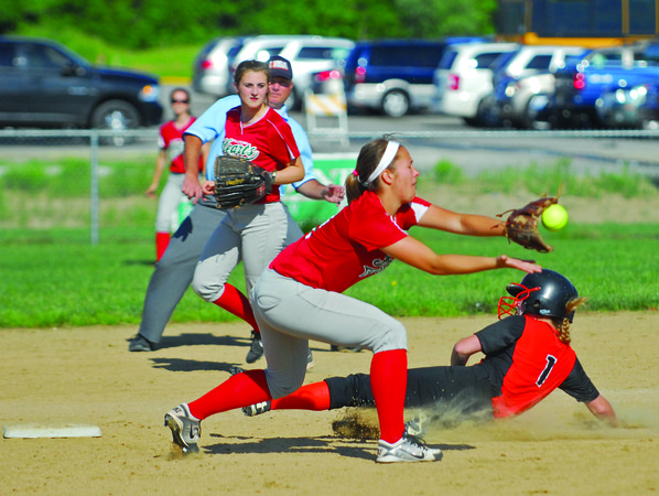 Effingham's Madison Weis catches an incoming throw as a Mt. Vernon runner steals second base.