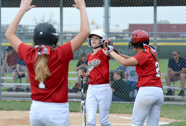 Effingham's Ashlyn Hanks is congratulated by Madison Weis (2) and Hope Collier (1) after scoring the game-winning run against Salem.