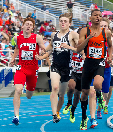 Effingham's Sean Zerrusen (left) rounds the south curve during the second lap of the 800-meter run. The Effingham senior finished first in his heat with a time of 1:58.31, advancing through to the finals.